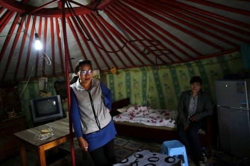 Baljirjantsan Otgonseren stands inside her family ger, a traditional Mongolian tent, in an area known as a ger district in Ulan Bator
