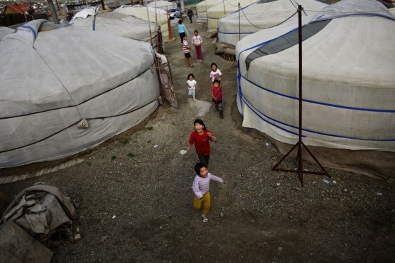Children play near gers, traditional Mongolian tents, in an area known as a ger district in Ulan Bator